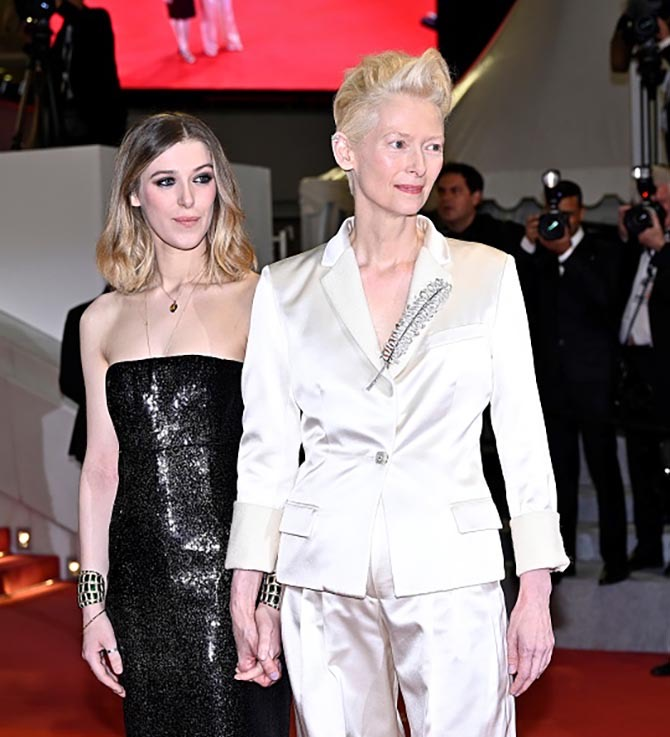 Tilda Swinton wearing a brooch by Chanel poses with her daughter Honor Swinton Byrne