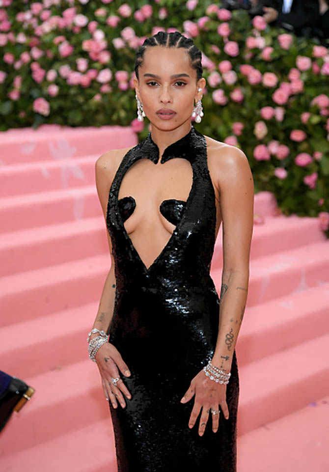 Zoe Kravitz wore earrings by Anabela Chan, Harry Kotlar studs and bracelets from Amwaj as well as a ring from Le Vian at The 2019 Met Gala