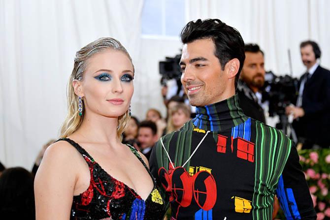 Sophie Turner in gem-set earrings with Joe Jonas attend The 2019 Met Gala