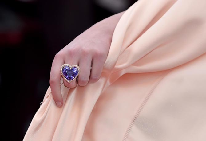 Detail shot of the heart ring by Chopard worn by Elle Fanning.