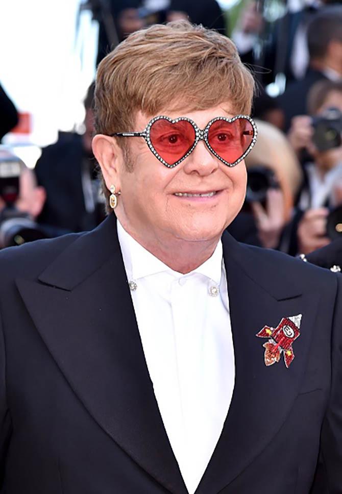 "Sir Elton John wore Chopard earrings at the the screening of ""Rocket Man"""