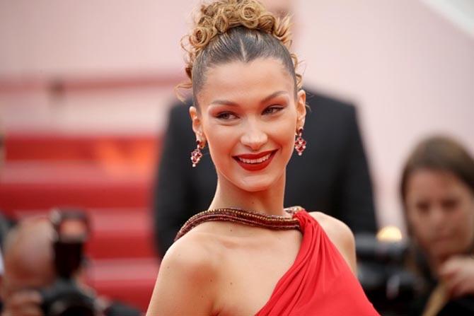Bella Hadid wore Bulgari earrings with a Roberto Cavalli Archive dress.
