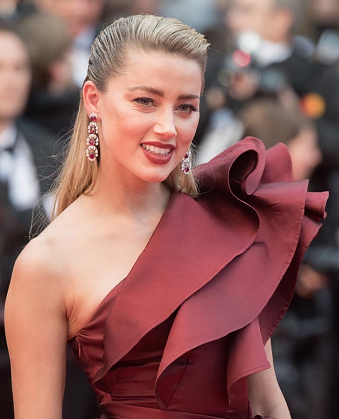 Amber Heard wore Chopard earrings and an Elie Saab gown.