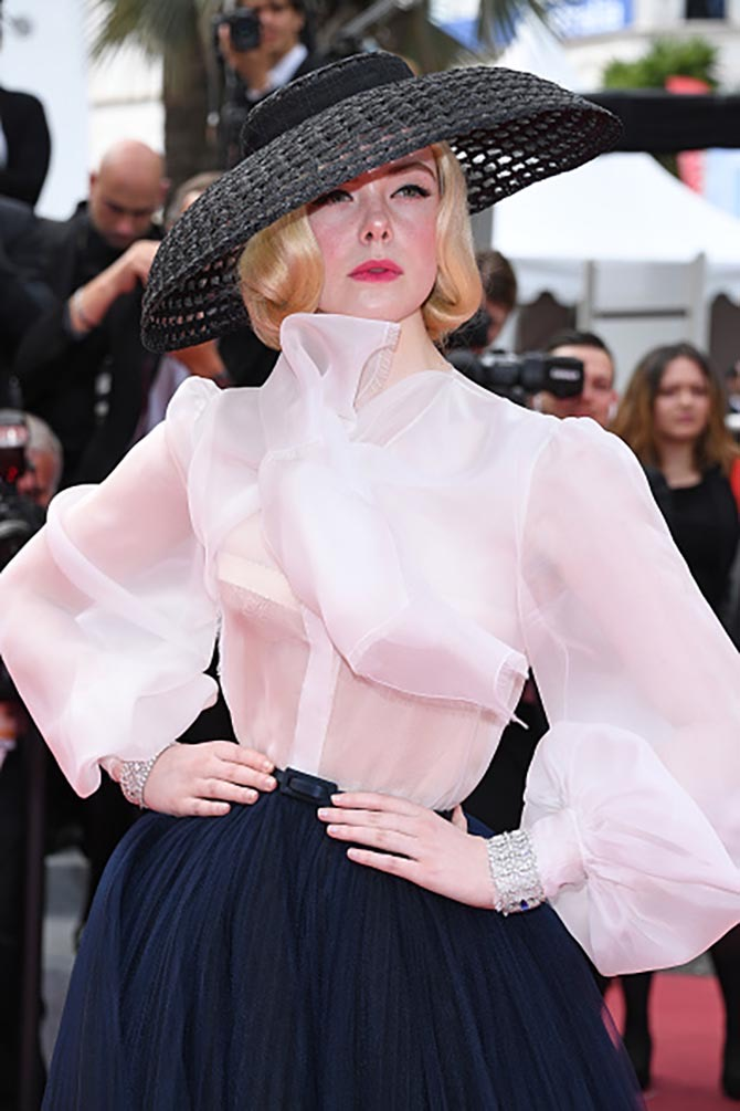 Elle Fanning wore diamond by Chopard with an ensemble from Dior.