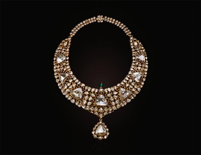 By repute this necklace being sold at Christie's belonged to the Nizam of Hyderabad. It is set with triangular-shaped table-cut diamonds, variously-shaped faceted and rose-cut diamonds, carved emerald bead, green enamel, foil, gold, mid-to late 19th century. Photo Christie's