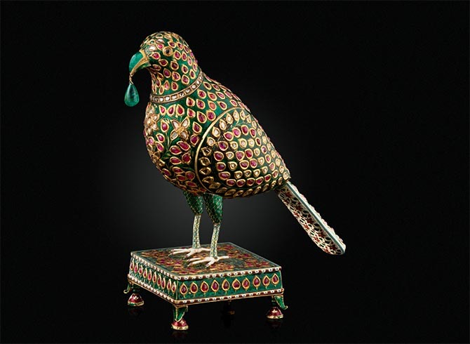 An enameled and gem set model of a parrot Hyderabad, Deccan, circa 1775-1825, from the Nizams of Hyderabad collection being sold at Christie's in the Maharajas & Mughal Magnificence sale. The object is covered in diamonds, rubies, emeralds and enamel. Photo Christie's