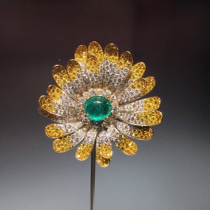 A big flower brooch made by Bvlgari in 1969 and set with an emerald, white and yellow diamonds in platinum show on display in BVLGARI, The Story, the Dream. Photo Marion Fasel