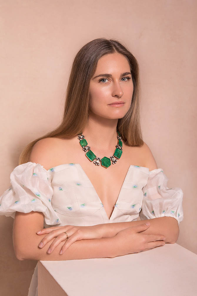Lauren Bush Lauren wearing an antique emerald, diamond and pearl necklace from the Maharajas & Mughal Magnificence auction in photo by Claiborne Swanson Frank for Christie's.