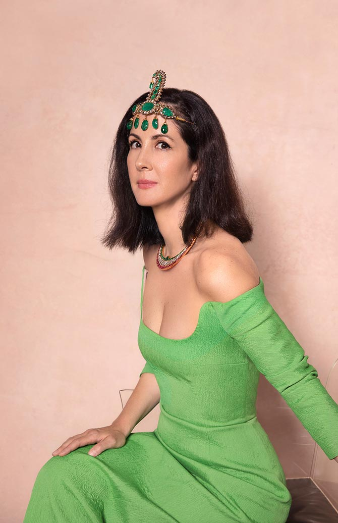 Patricia Herrera Lansing wearing an antique emerald and diamond Sarpech and an antique diamond, emerald, ruby and enamel collar necklace from the Maharajas & Mughal Magnificence auction in photo by Claiborne Swanson Frank for Christie's.