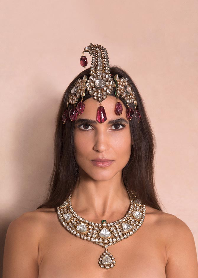 Teresa Lourenco wearing 'The Nizams of Hyderabad Sarpech,' an antique diamond, spinel, pearl and enamel sarpech as well as 'The Nizam Of Hyderabad Necklace,' an antique diamond, emerald and enamel necklace from the Maharajas & Mughal Magnificence auction in photo by Claiborne Swanson Frank for Christie's.