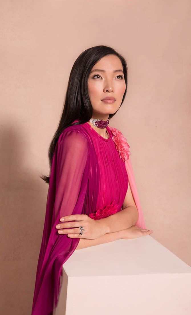 Zin Li wearing 'The Patiala Ruby Choker,' an Art Deco ruby, diamond and natural pearl choker necklace by Cartier and 'The Pink Golconda Diamond,' a 10.46-carat colored diamond and diamond ring by JAR from the Maharajas & Mughal Magnificence auction in photo by Claiborne Swanson Frank for Christie's.