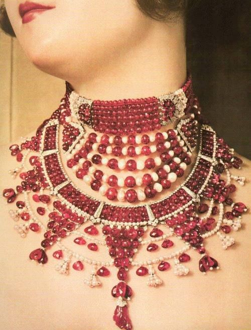 The complete Patiala Ruby Necklace by Cartier on a model around 1931. Photo via