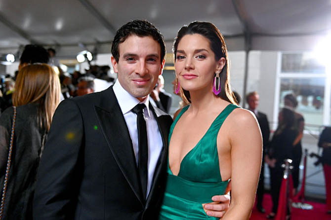 Jarrod Spector with Kelli Barrett who wore pink earrings with her green gown.