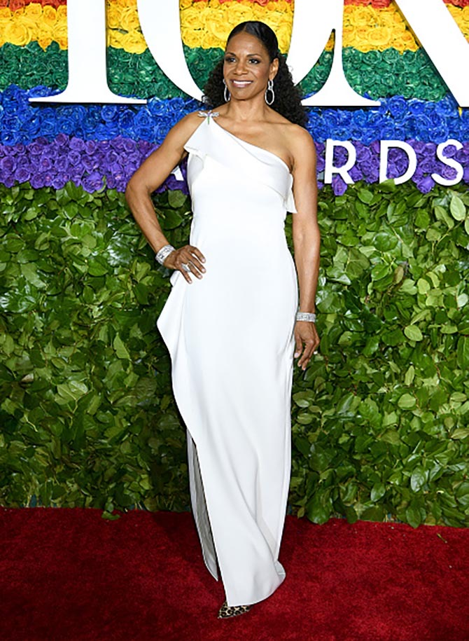 Audra McDonald wore diamond jewelry with a white gown.