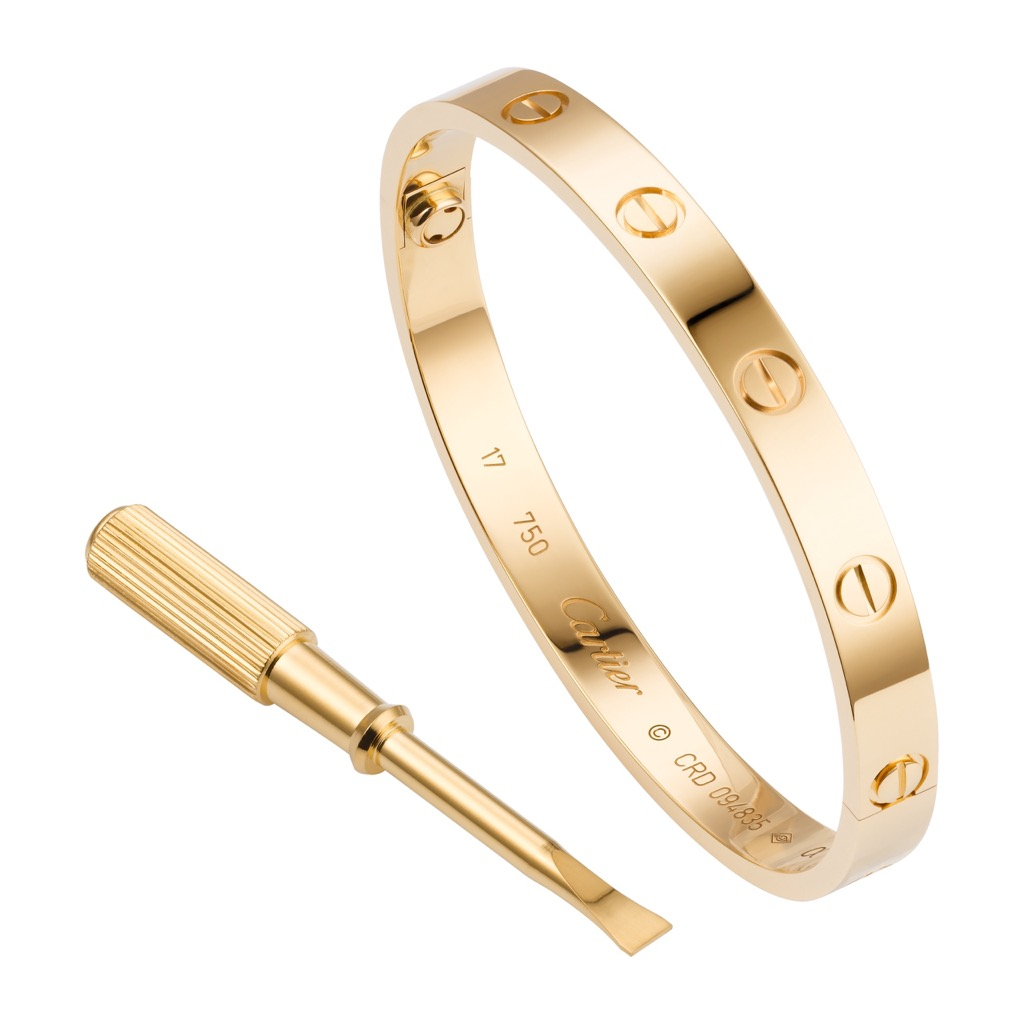 The gold Cartier Love bracelet comes with a vermeil screwdriver that is used to put it on the wrist and take it off. Photo courtesy