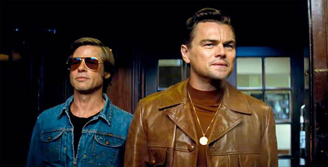 Brad Pitt with Leonardo DiCaprio who is wearing a pendant necklace by Staurt England in 'Once Upon A Time In...Hollywood.'