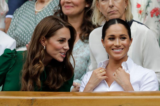 Kate Middleton and Meghan Markle who is wearing a Goddess Durga Round Ring by Pippa Small.