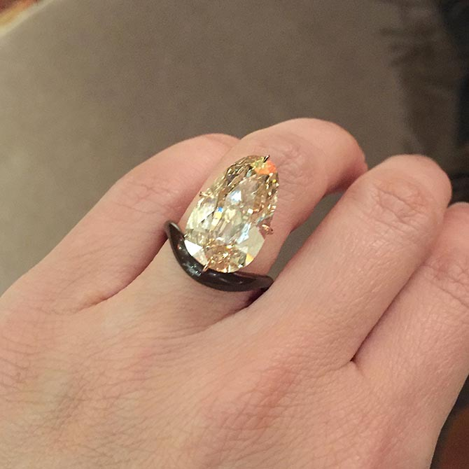 James de Givenchy ring I tried on at TEFAF that has all the design hallmarks of Scarlett Johansson's engagement ring from Colin Jost. Photo via Instagram @TheAdventurine
