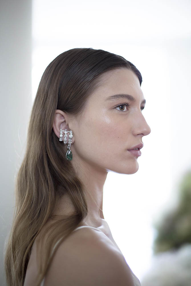 Diamond and Emerald Daphne Earring by Ana Khouri shown on a model in Paris.
