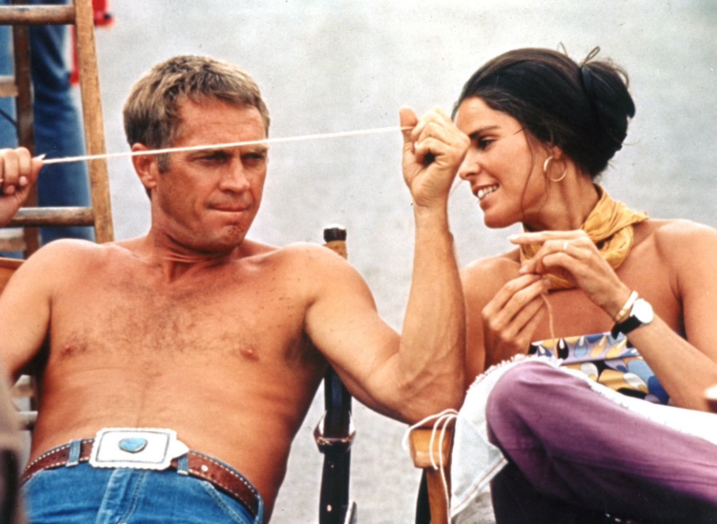 Steve McQueen with Ali MacGraw who is wearing a Cartier Love bracelet on the 1972 set of The Getaway Photo: Entertainment Pictures