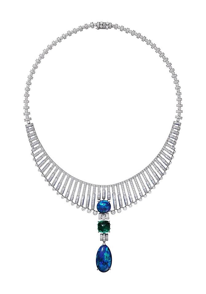 Cartier Magnitude High Jewelry transformable pendant necklace composed of 18K white gold, one 5.32- carat sugarloaf emerald from Colombia, two cabochon-cut black opals from Australia totaling 25.24-carats, lapis lazuli, baguette-cut diamonds, brilliant-cut diamonds. The pendant can be removed and worn as a brooch. Photo courtesy