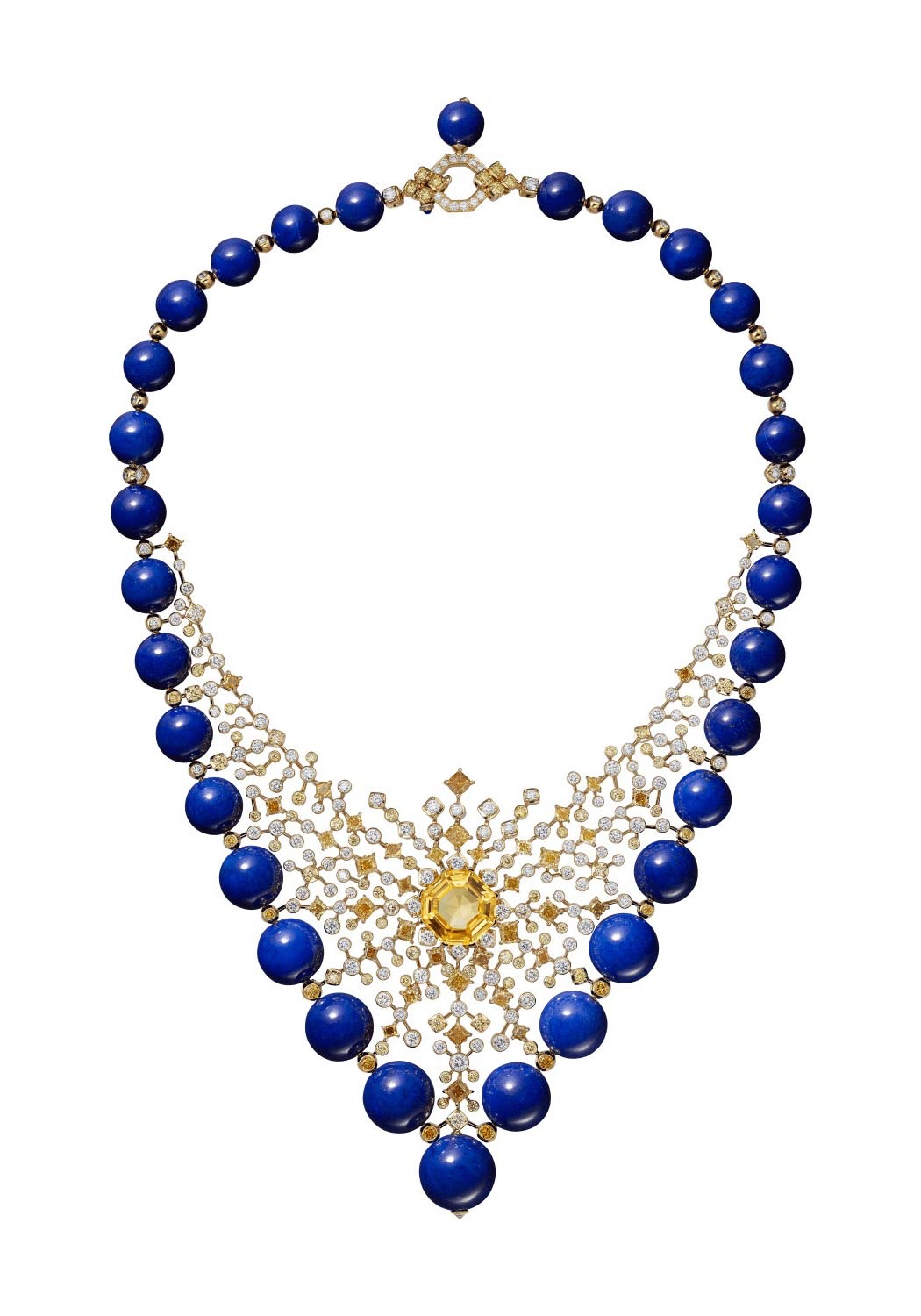 Cartier Magnitude High Jewelry necklace composed of 18K yellow gold, a 15.48-carat octagonal yellow sapphire from Ceylon, lapis lazuli beads, yellow and orange cushion-shaped diamonds, yellow, orange, and white brilliant-cut diamonds. Photo courtesy