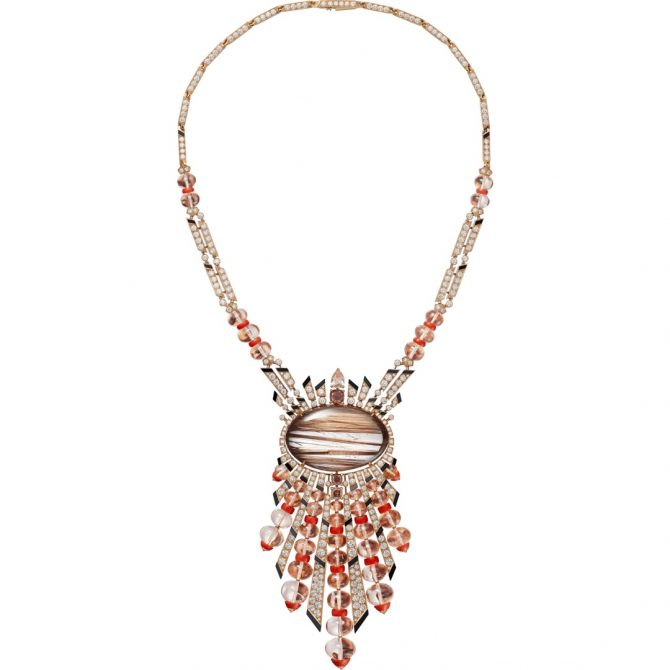 Cartier Magnitude High Jewelry necklace composed of 18K rose gold, a 68.85-carat cabochon-cut rutilated quartz, a 0.74-carat fancy brown-pink pear-shaped diamond, a 1.01-carat fancy deep brownish orangey pink cushion-shaped diamond, a 0.53-carat fancy brown-pink cushion-shaped diamond, a 0.50-carat fancy deep orangey pink cushion-shaped diamond, morganite beads, coral, onyx, brilliant-cut diamonds. Photo courtesy