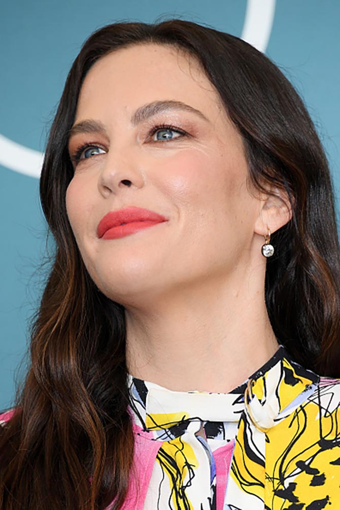 "Liv Tyler wore diamond button back pendant earrings at the ""Ad Astra"" photocall"