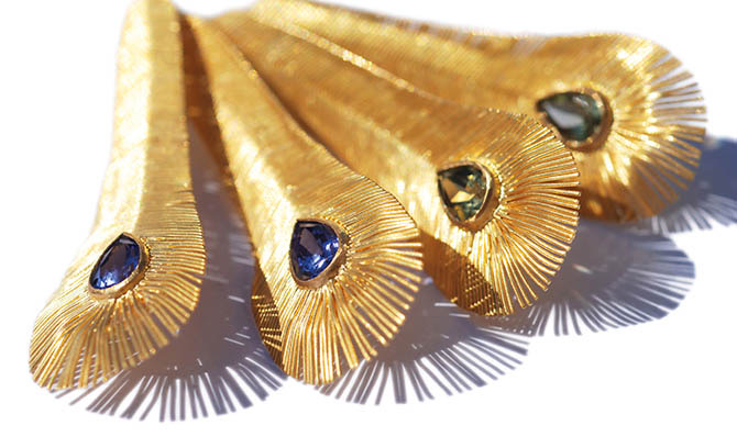 Gold feather earrings by Marie-Hélène de Taillac have gems set in the eyes. Photo courtesy