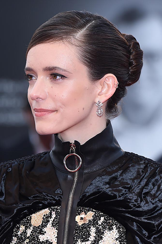 "Stacy Martin wore vintage-style diamond earrings with her upper ear small hoops at the Opening Ceremony and the ""La Vérité"" (The Truth) screening during the 76th Venice Film Festival at Sala Grande on August 28, 2019 in Venice, Italy."