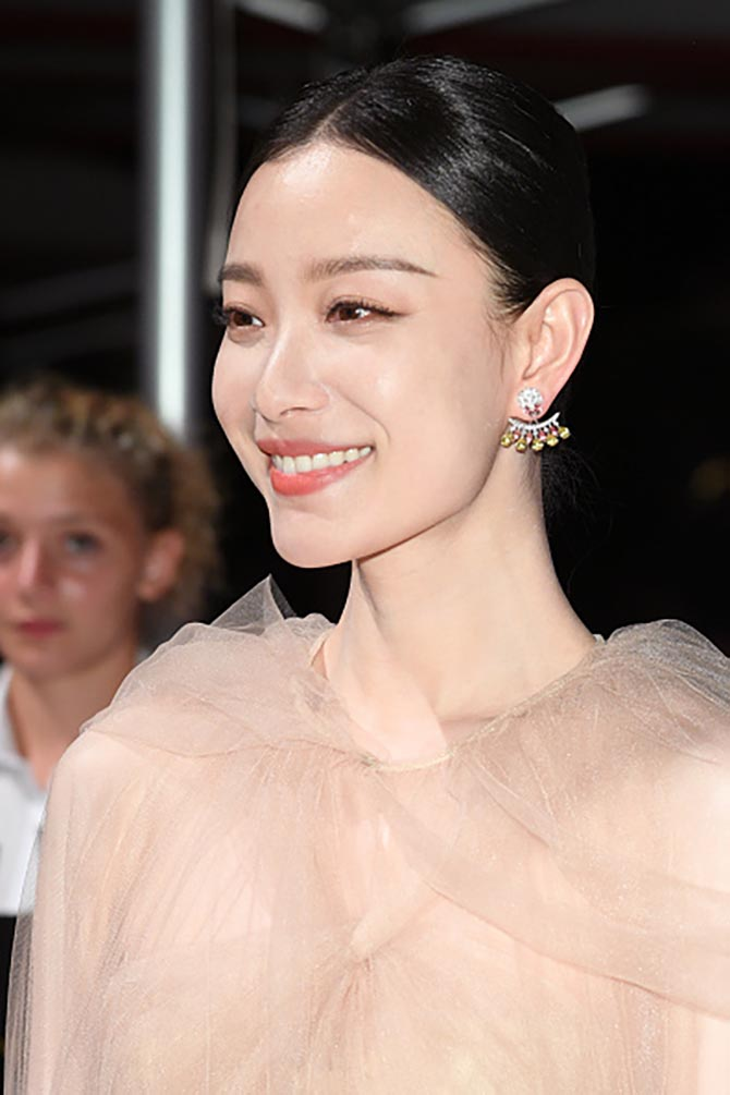 Ni Ni wore front to back diamond earrings at the opening ceremony dinner during the 76th Venice Film Festival at Excelsior Hotel on August 28, 2019 in Venice, Italy.
