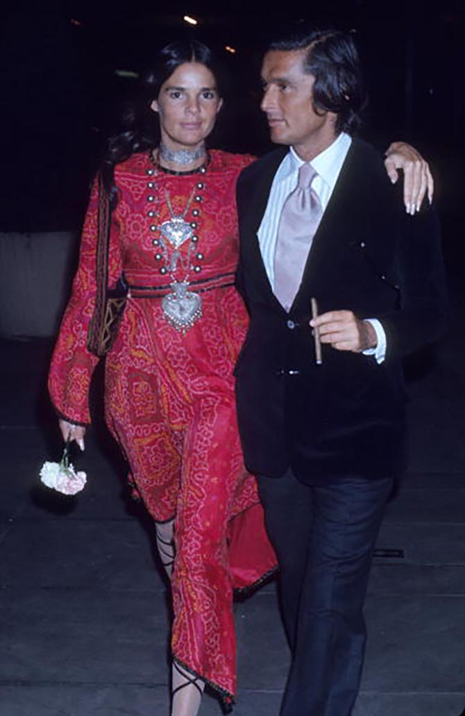 Outside the 21 Club in New York in June of 1970, Robert Evans with Ali MacGraw who is wearing a choker and several silver jewels.