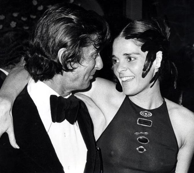 At the 1972 premiere of The Godfather Robert Evans with Ali MacGraw who wore her collection of antique style brooches pinned to the front of her dress.