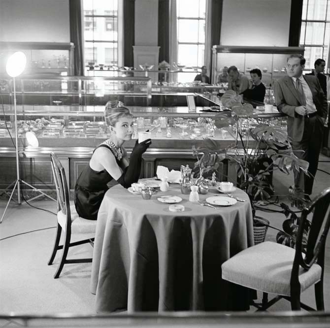 Audrey Hepburn touching up her makeup at Tiffany's behind the scenes of the filming of Breakfast at Tiffany's.