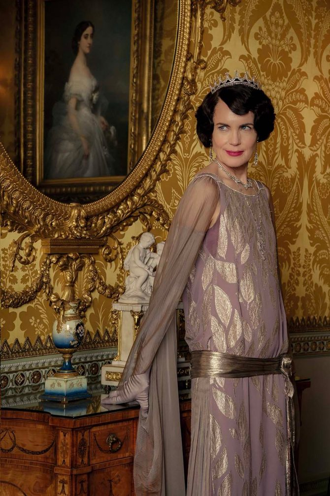 Lady Cora, Countess of Grantham (Elizabeth McGovern), is her typical comforting and useful self, while sporting delicate Edwardian filigree that sits high atop her head during the final formal ball scene. The Edwardian jewel comes from Bentley & Skinner.
