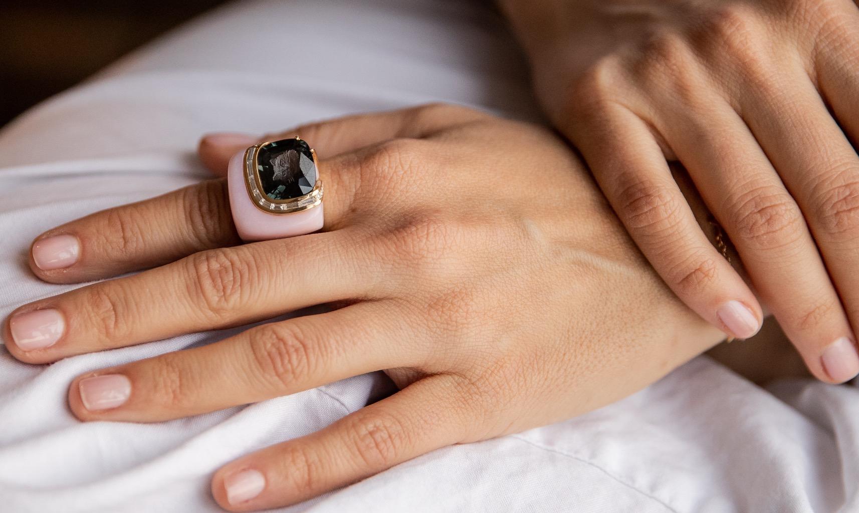 Maria Dueñas Jacobs wearing her Millie & Noah intaglio ring depicting her cat Frankie. Photo Jeff Thibodeau