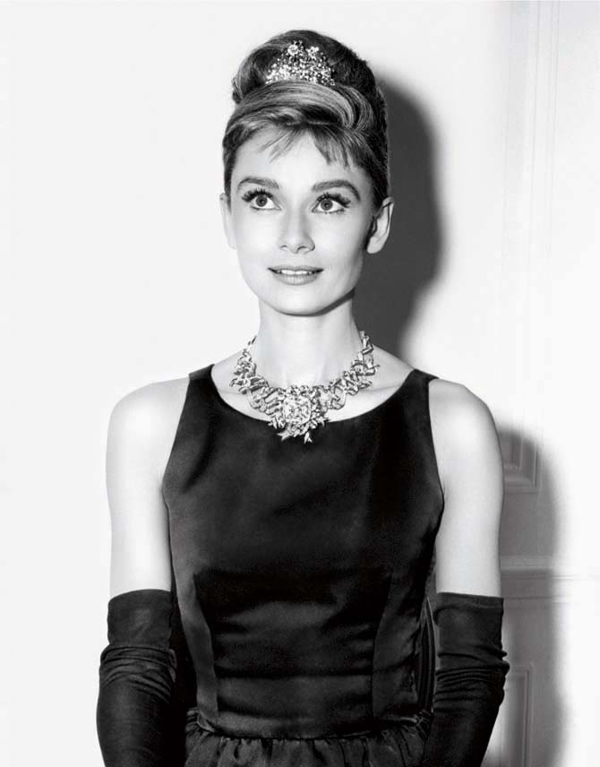 Audrey Hepburn in her 'Breakfast at Tiffany's' costume modeling a Schlumberger ribbon necklace set with the Tiffany Diamond. Photo © Paramount Pictures/Sunset Boulevard/Corbis