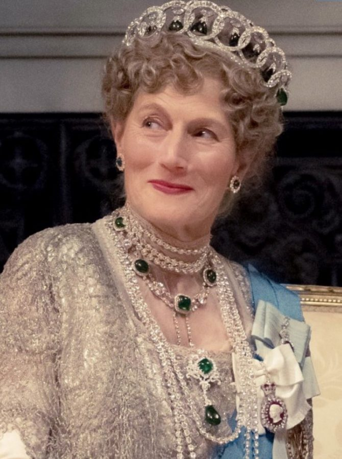 Fittingly, Downton Abbey pulls out all of the jewelry stops for its fictional Queen Mary (played by Geraldine James). She wears a faithful reproduction of the famous diamond Vladimir tiara (reportedly Elizabeth II's favorite), together with the legendary Cambridge emeralds and the Delhi Duhrbar necklace and suite. The top of the jewelry food chain, it is a glorious display of jewelry dominance and a fitting, glittering exclamation point to the end of the story so far.