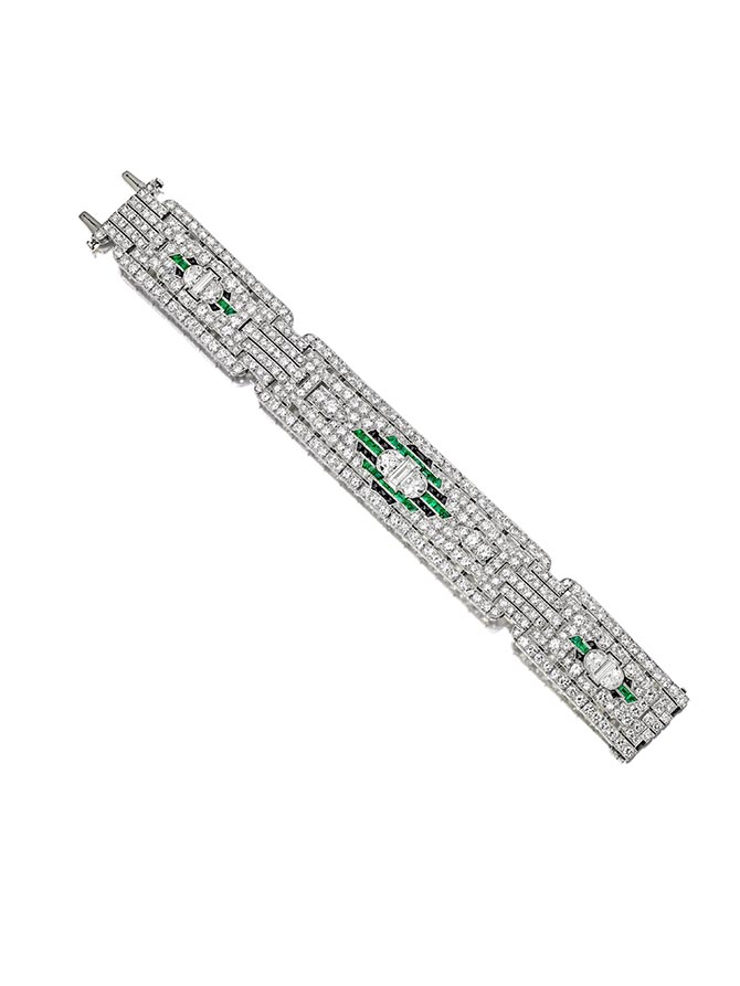 NEW YORK LOT 69 – A very fine diamond, emerald and onyx bracelet, circa 1925