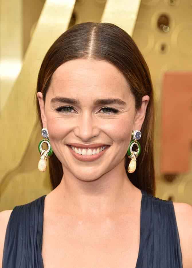 Emilia Clarke in David Webb earrings at the Emmys