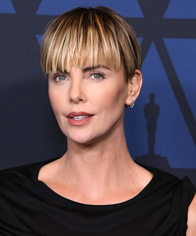 Charlize Theron wore jewels by Ana Khouri.