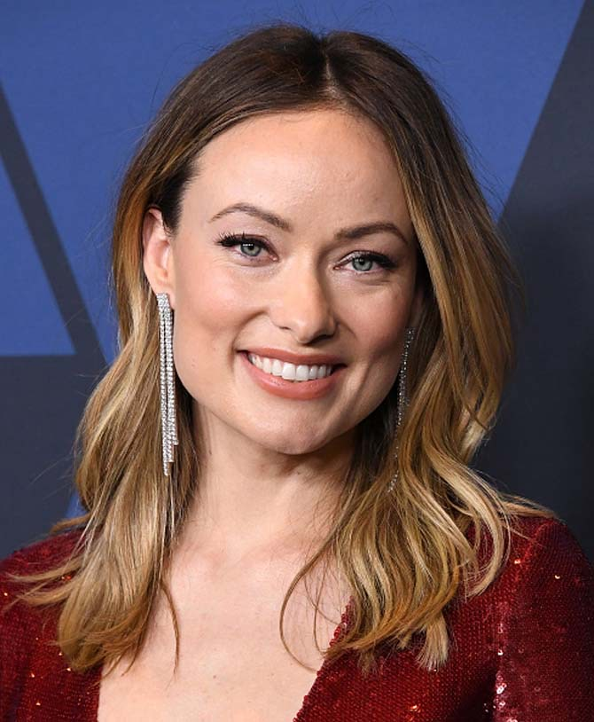 Olivia Wilde wore diamond earrings by Amwaj.