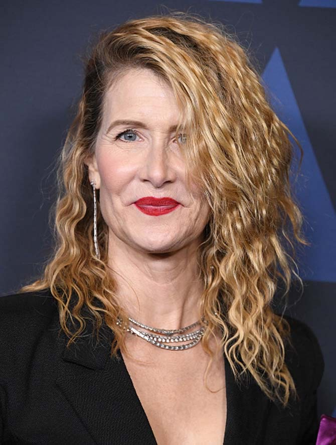 Laura Dern in long earrings and multiple chokers.