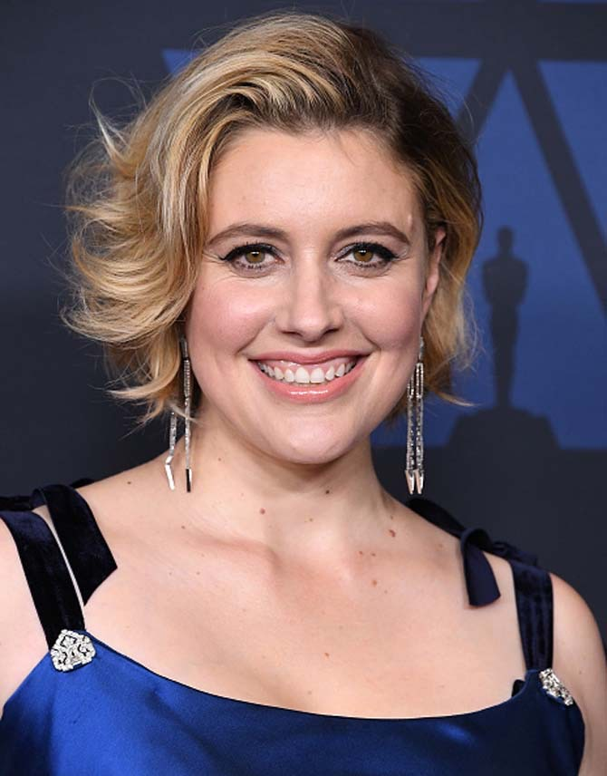 Greta Gerwig wore Nikos Koulis earrings.