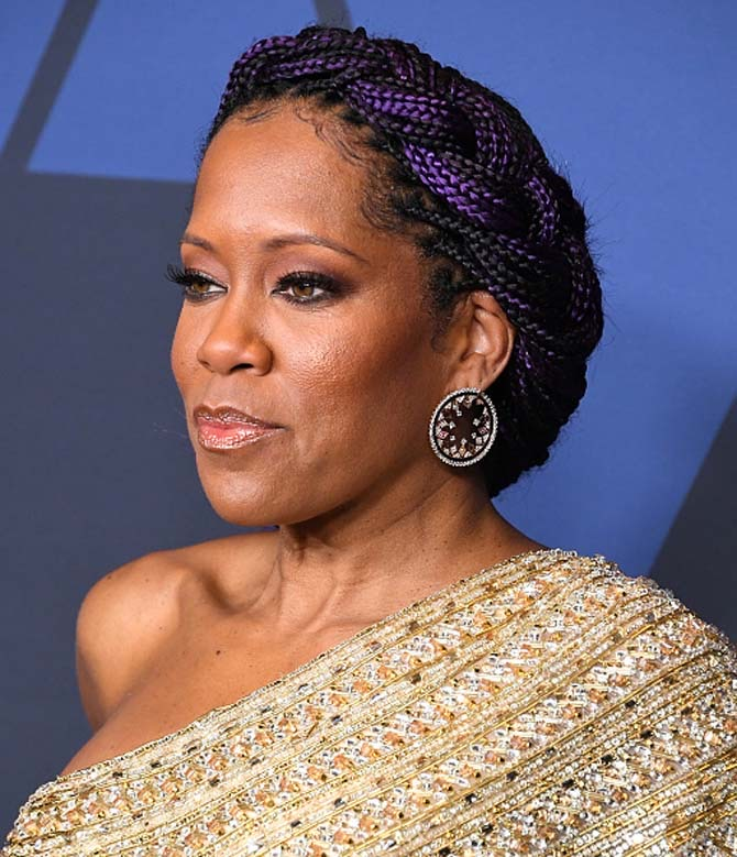 Regina King arrives wore large circular shaped earrings.