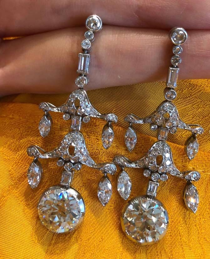 Christine showing her followiers some Art Deco diamond earrings at Simon Teakle. Photo via Instagram @christinechengny