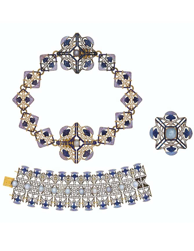 A RARE SUITE OF ART NOUVEAU ENAMEL, STAR SAPPHIRE AND DIAMOND 'THISTLE' JEWELRY, RENÉ LALIQUE Dark blue, lavender and pink enamel, oval and pyramid-shaped cabochon star sapphires, old and rose-cut diamonds, 18k gold (French marks), necklace 14 ¾ ins., bracelet 6 ½ ins, brooch 2 ins., necklace may be worn as two bracelets, circa 1900, each signed Lalique, each with maker's mark, blue R. Lalique fitted case