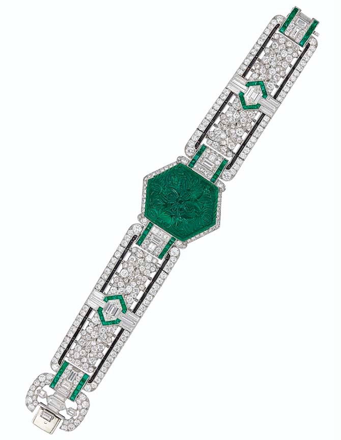 ART DECO CARVED EMERALD, DIAMOND AND ONYX BRACELET, OSCAR HEYMAN & BROTHERS Hexogonal-shaped carved emerald, calibré-cut emeralds, old, single, baguette and hexagonal-cut diamonds, onyx plaques, platinum, 7 3/8 ins., circa 1925, unsigned, no. 15133 Oscar Heyman & Brothers, 2019: Certificate of Authenticity Accompanied by a copy of an archival drawing of the bracelet by Oscar Heyman & Brothers, numbered 15133