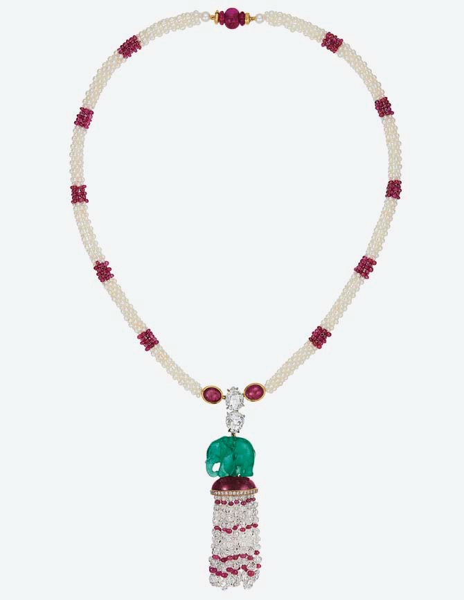 CARVED EMERALD ELEPHANT, RUBY, DIAMOND AND SEED PEARL NECKLACE, CARVIN FRENCH Carved emerald elephant, oval cabochon rubies, ruby beads, faceted diamond beads, pear-shaped rose-cut and circular-cut diamonds, seed pearls, gold and platinum, circa 1984, 19 ins., unsigned