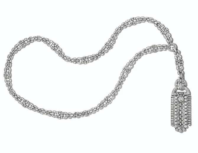 A SENSATIONAL ART DECO DIAMOND SAUTOIR, VAN CLEEF & ARPELS Old, single, baguette, square and shield-shaped diamonds, platinum (French marks), neckchain 31 ½ ins., tassel 6 7/8 ins., neckchain may be separated into smaller segments and worn as bracelets, choker and a pendant, 1928, signed Van Cleef & Arpels, 'Paris', workshop marks (Rubel Frères), nos. 30216, 38277